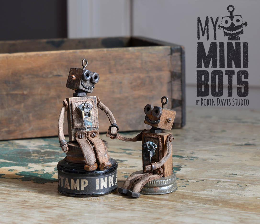 Tiny Robots holding hands Robin Davis Studio